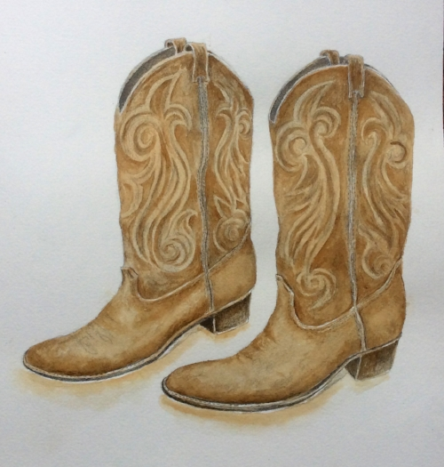 Vintage cowboy boots painted with coffee.