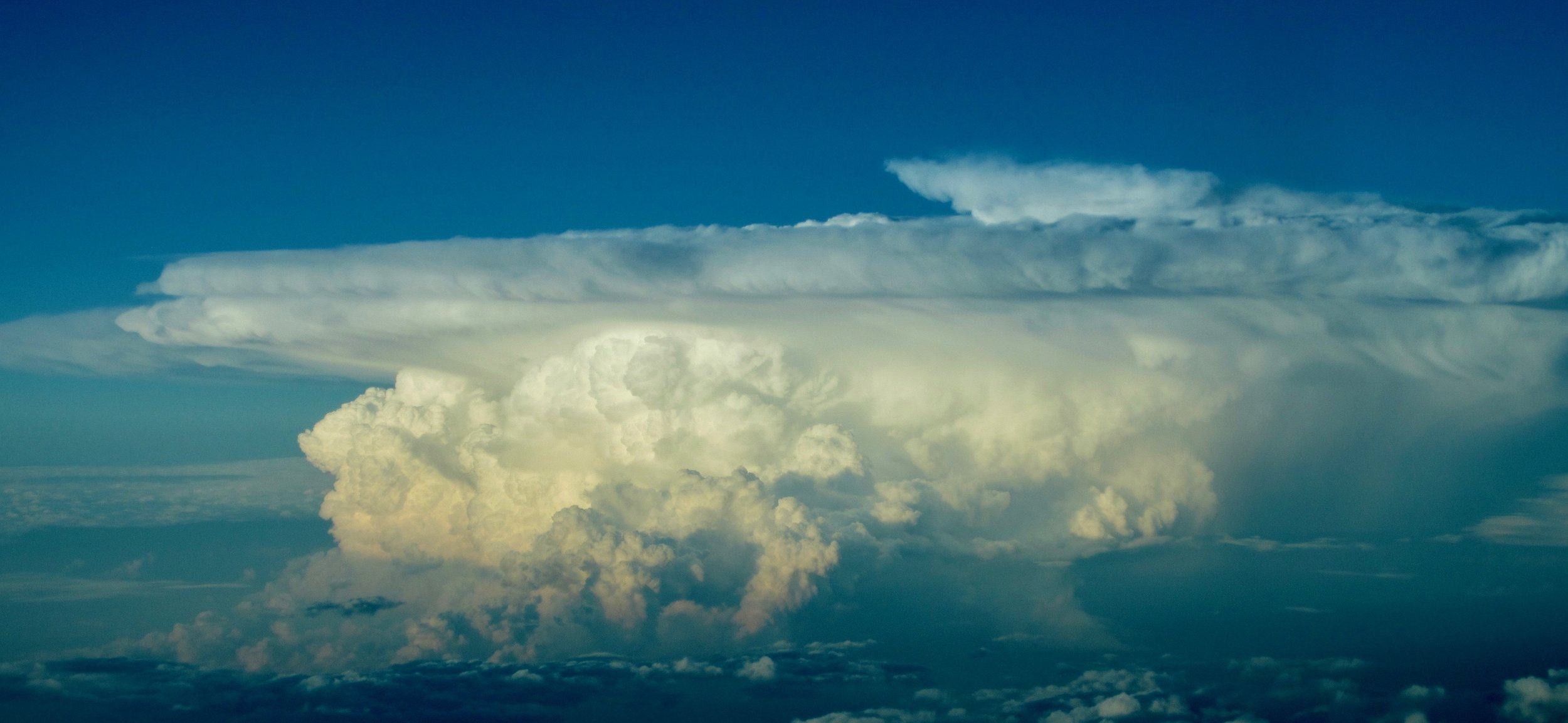"An anvil and a fully developed thunderstorm. This guy hit the tropopause hence the blacksmith looking anvil. I called this inversion or isothermal layer a tropopause inversion. I took a pic of this ""bad boy"" over Montana. It flirted to FL 460 or so, well above an airliner's maximum height."