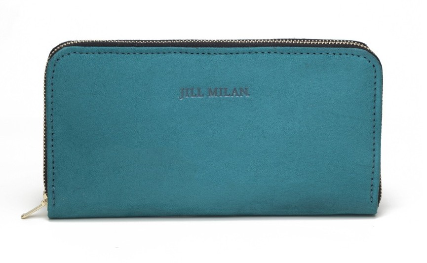 Made in the USA from italian-sourced microsuede and organic cotton, this zip-around Jill Milan purse just screams good craftsmanship. Find it   here .