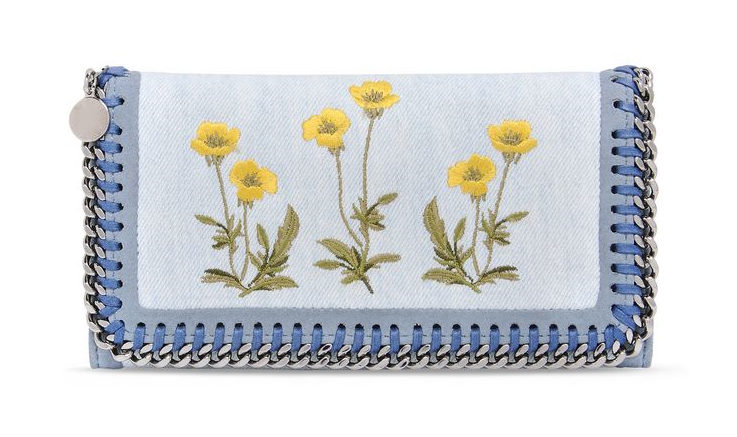 We love the individuality of this floral Stella McCartney wallet, with its contrasting detailing of denim, botanically threaded embroidery and ruthenium chain. Better still, the lining is made from recycled plastic bottles. Find it   here  .