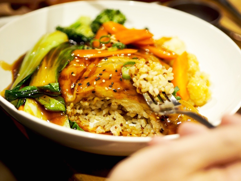 Teriyaki Wheat Chicken, served with biodynamic brown rice, steamed vegetables and house-made pickles.