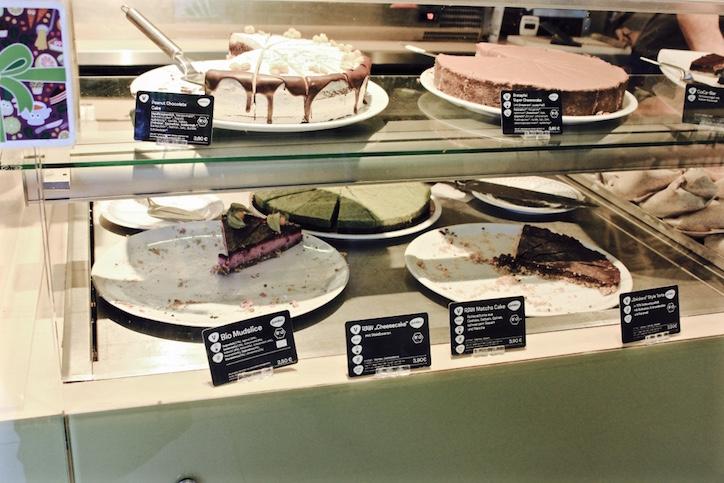 Cabinet full of vegan cakes at Goodies