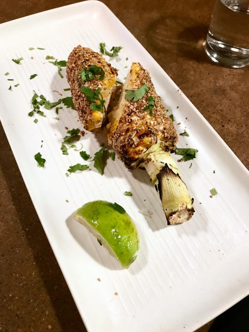 Grilled corn with vegan aioli + crushed pepitas at Gracias Madre in San Francisco