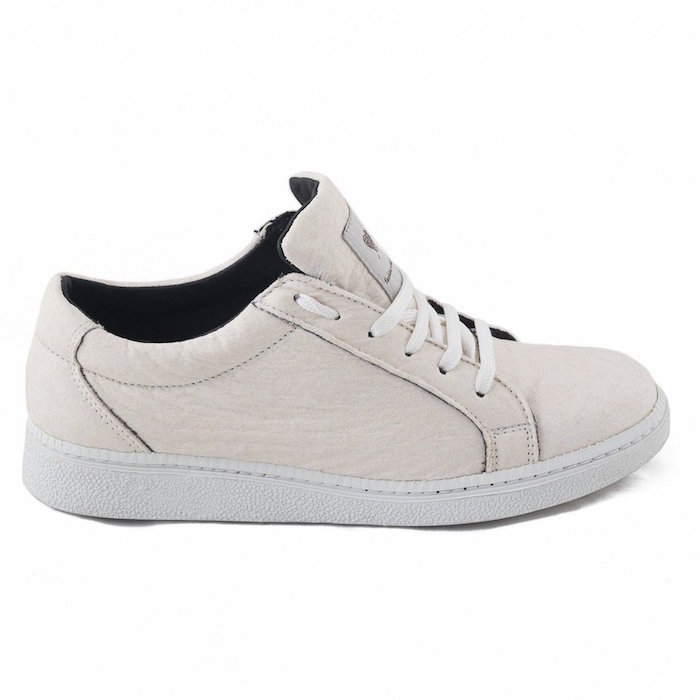 Sustainable vegan white sneakers made from eco, vegan material Pinatex - pineapples leaves.