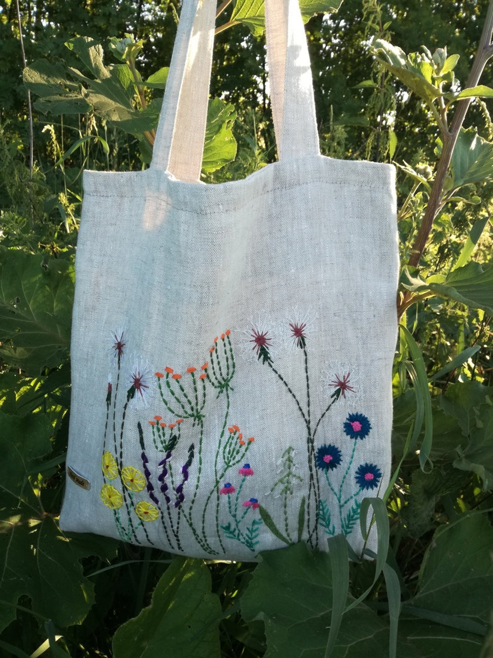 Flirtily Floral - A linen bag, daintily embroidered with springing flowers. Hand made in Belarus, this is so pretty it can go straight from the market to a picnic in a park!