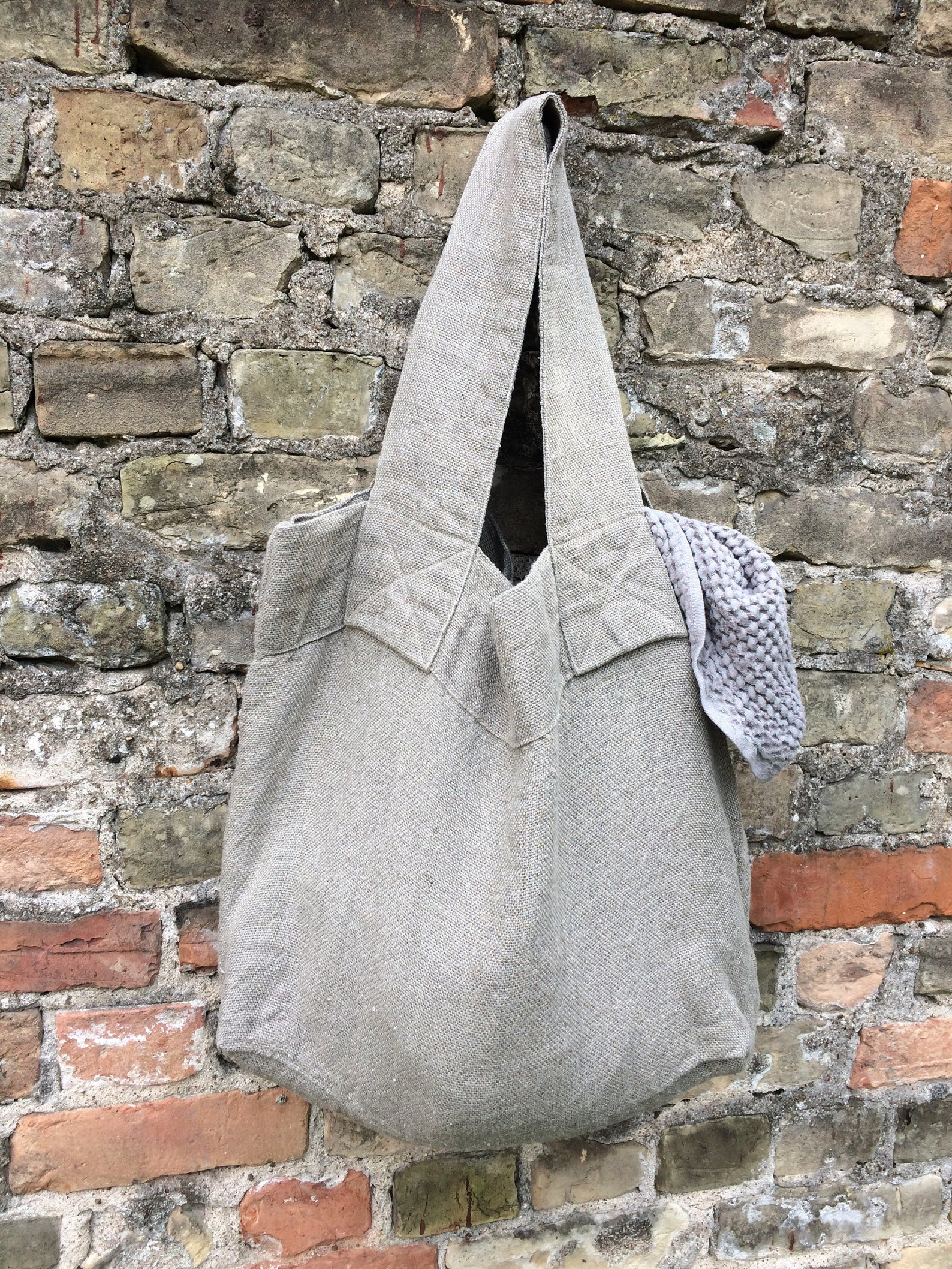 Serious stuff. - With reinforced handles, this natural linen tote is sewn for serious use. Perfect for gathering a windfall of apples at the farmer's market, this bag is made from Oeko Tex certified linen in Latvia. Seriously practical, but seriously chic too!