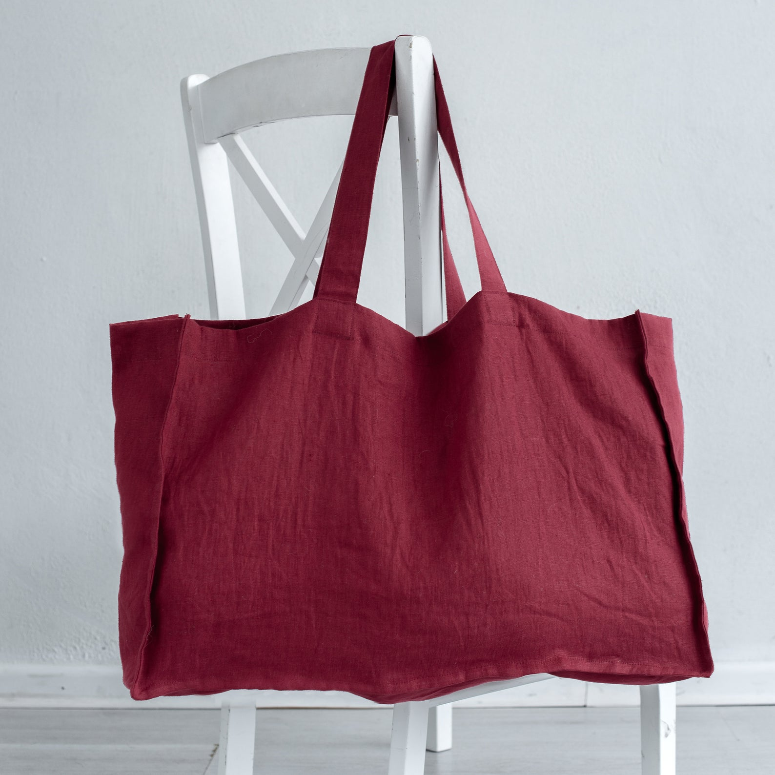 Hidden pockets - Made from Oeko Tex certified European linen in Lithuania, we're loving the luscious raspberry colour of this large tote bag. It also comes in a gorgeous moss green, and 15 other earthy tones. Hand made to order, it's a classic tote to keep on hand for shopping days.