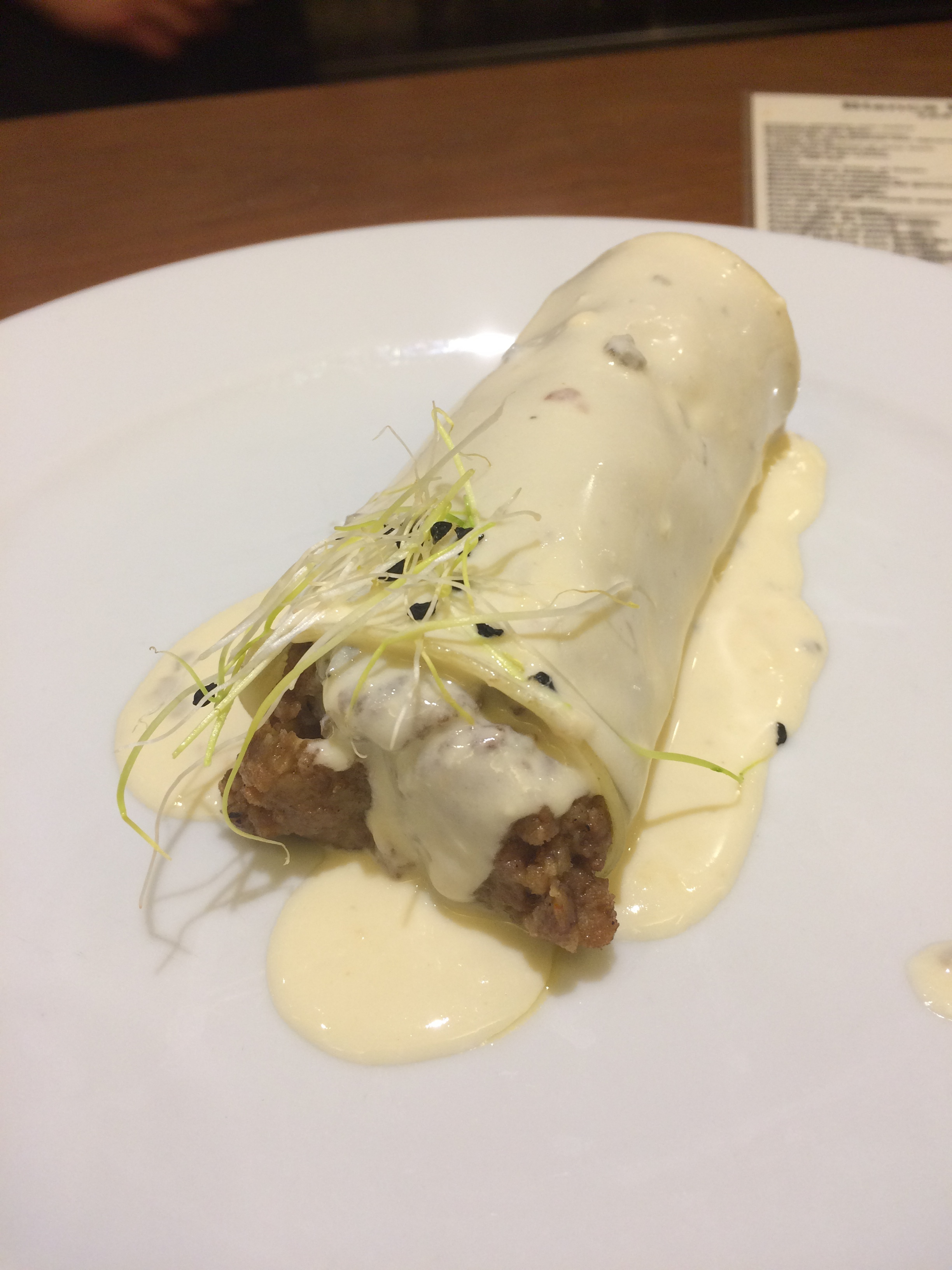 Minced pork filled cannelloni with blue cheese sauce