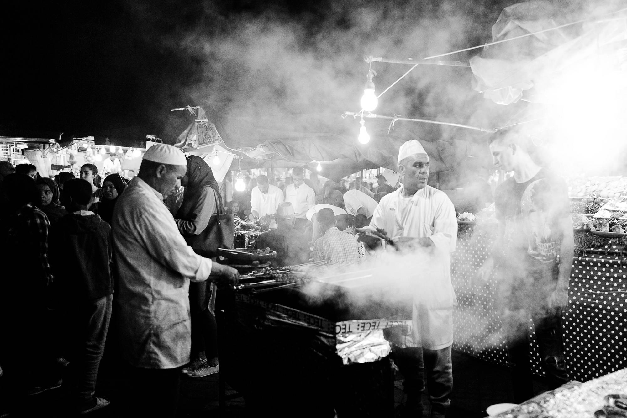 Morocco Marrakech street vendor night black and white photo