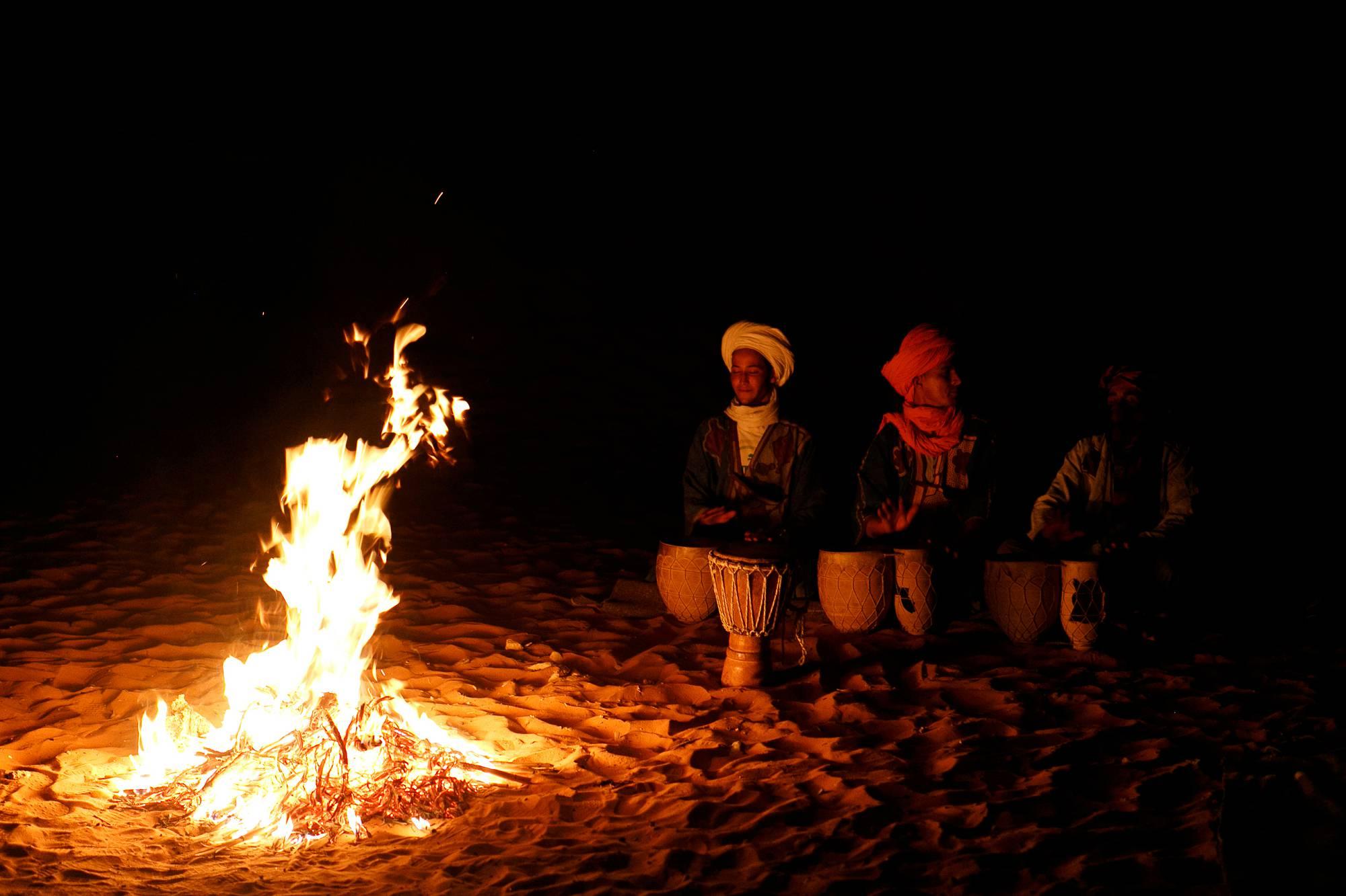 Morocco Sahara night Gnawa musician