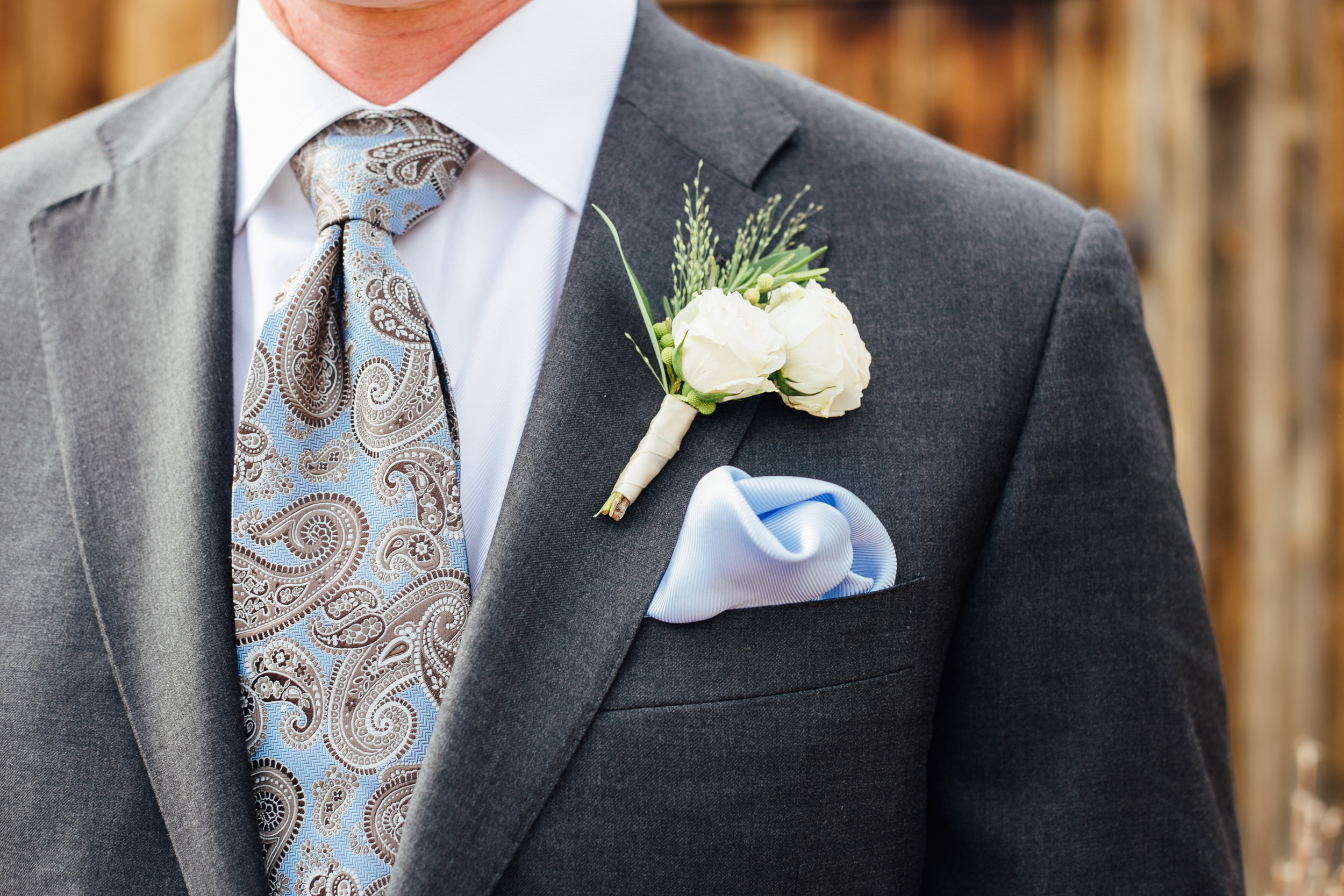 Groom with Boutonniere with Pale Blue Paisley Tie Little Thompson Valley Pioneer Museum Berthoud Colorado Wedding