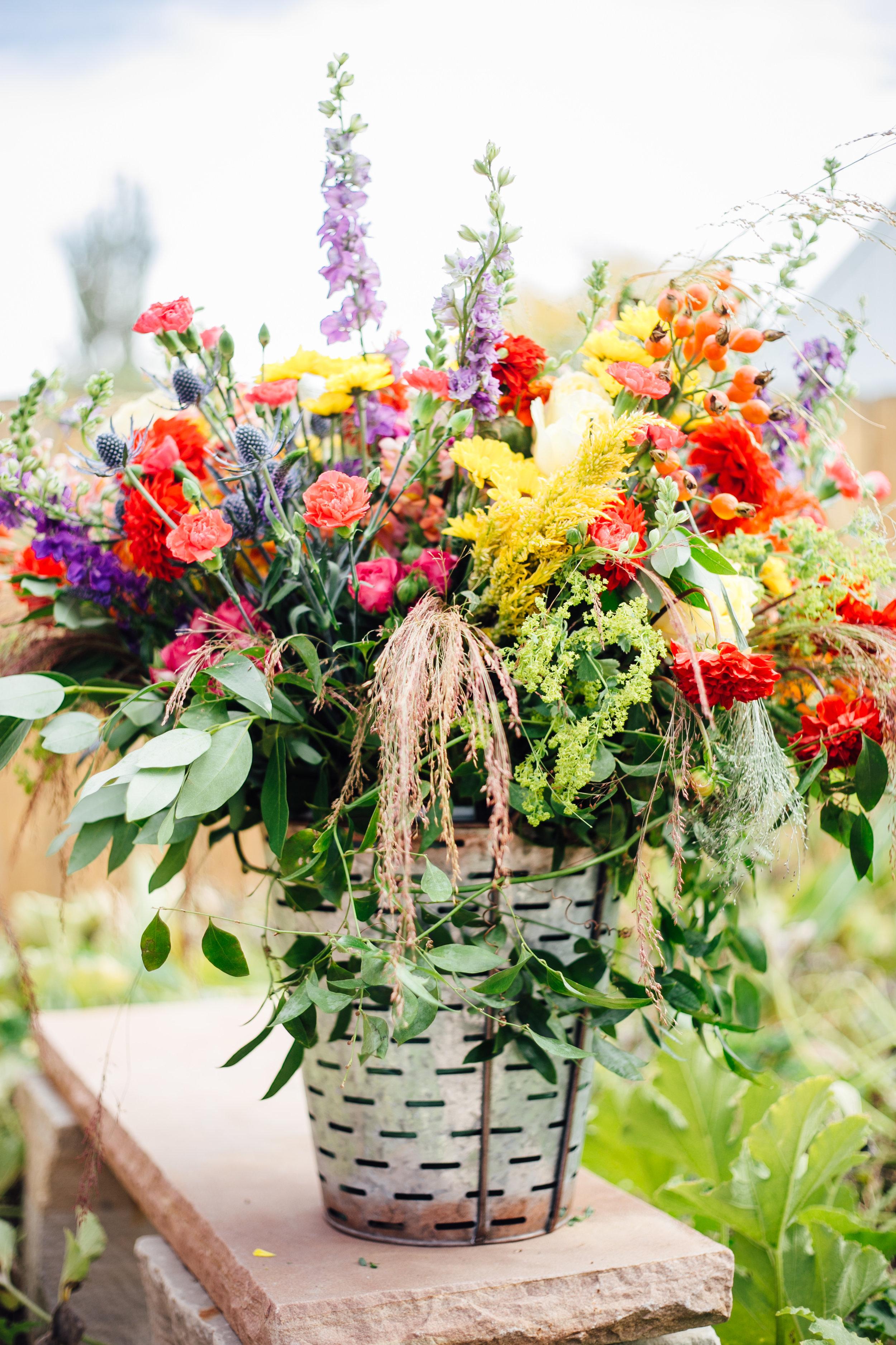 Bright Flower Arrangement in Metal Pot  Little Thompson Valley Pioneer Museum Berthoud Colorado Wedding
