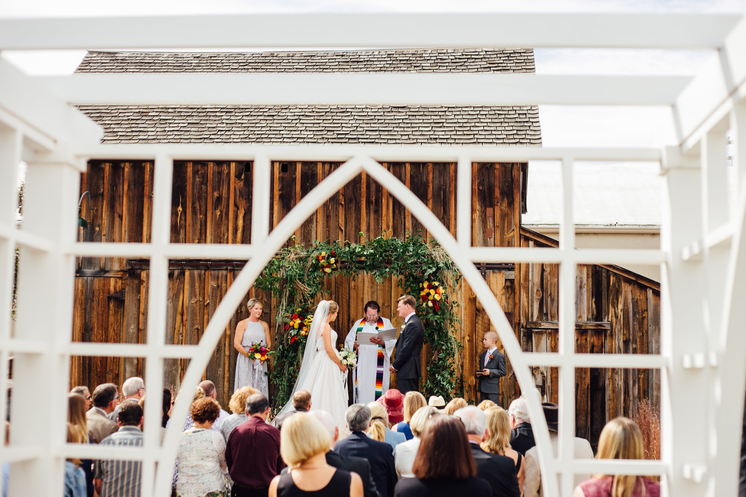 Bride and Groom, Wedding Ceremony, Lattice Window, Little Thompson Valley Pioneer Museum Berthoud Colorado Wedding