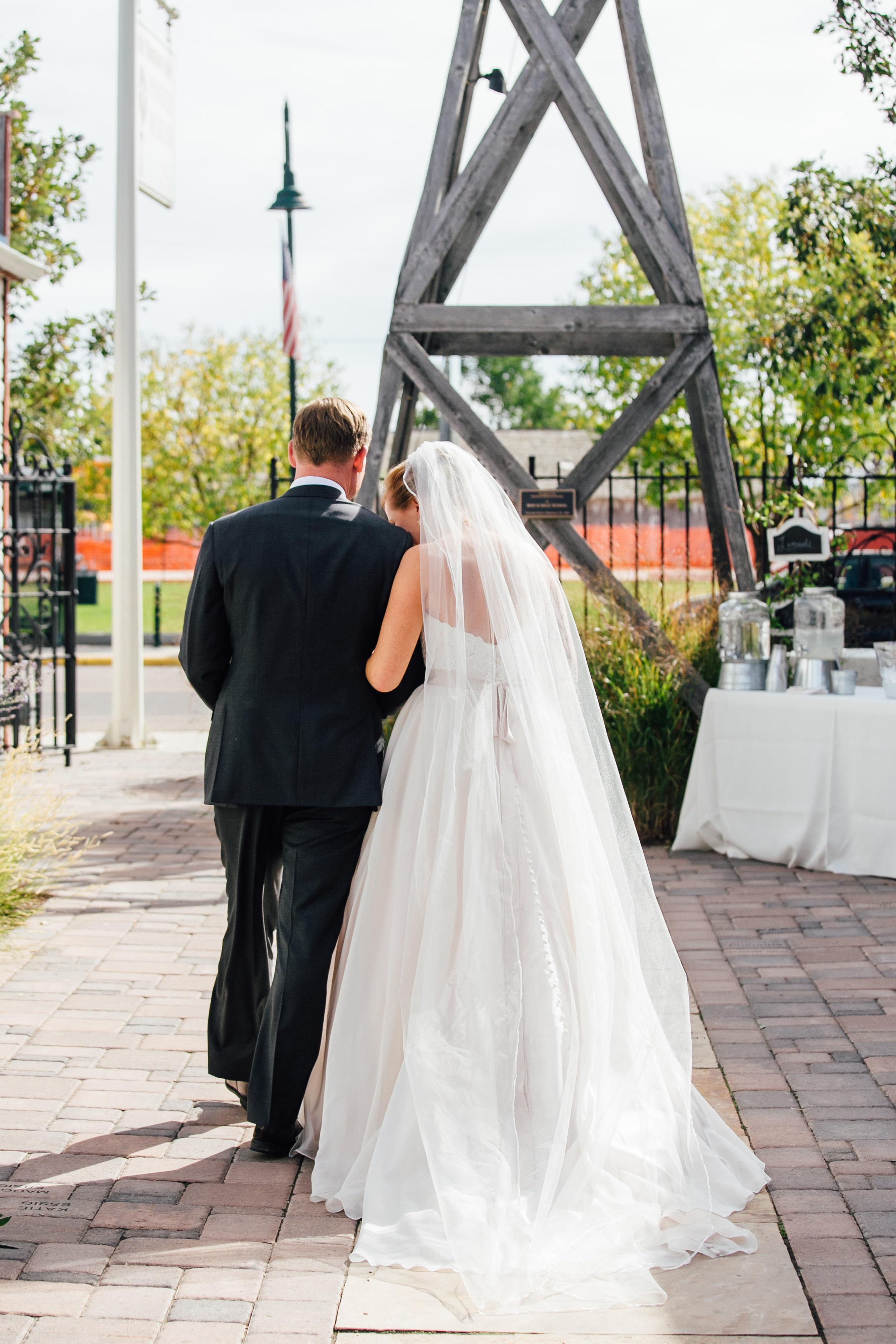 Bride and Groom Exit Wedding Ceremony Little Thompson Valley Pioneer Museum Berthoud Colorado Wedding
