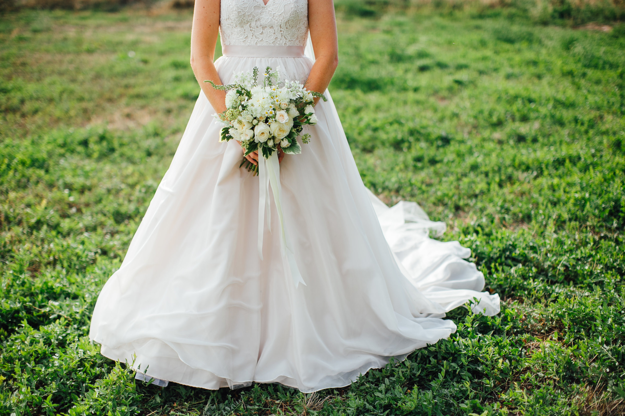 Bride Alone with White Wedding Bouquet  Little Thompson Valley Pioneer Museum Berthoud Colorado Wedding
