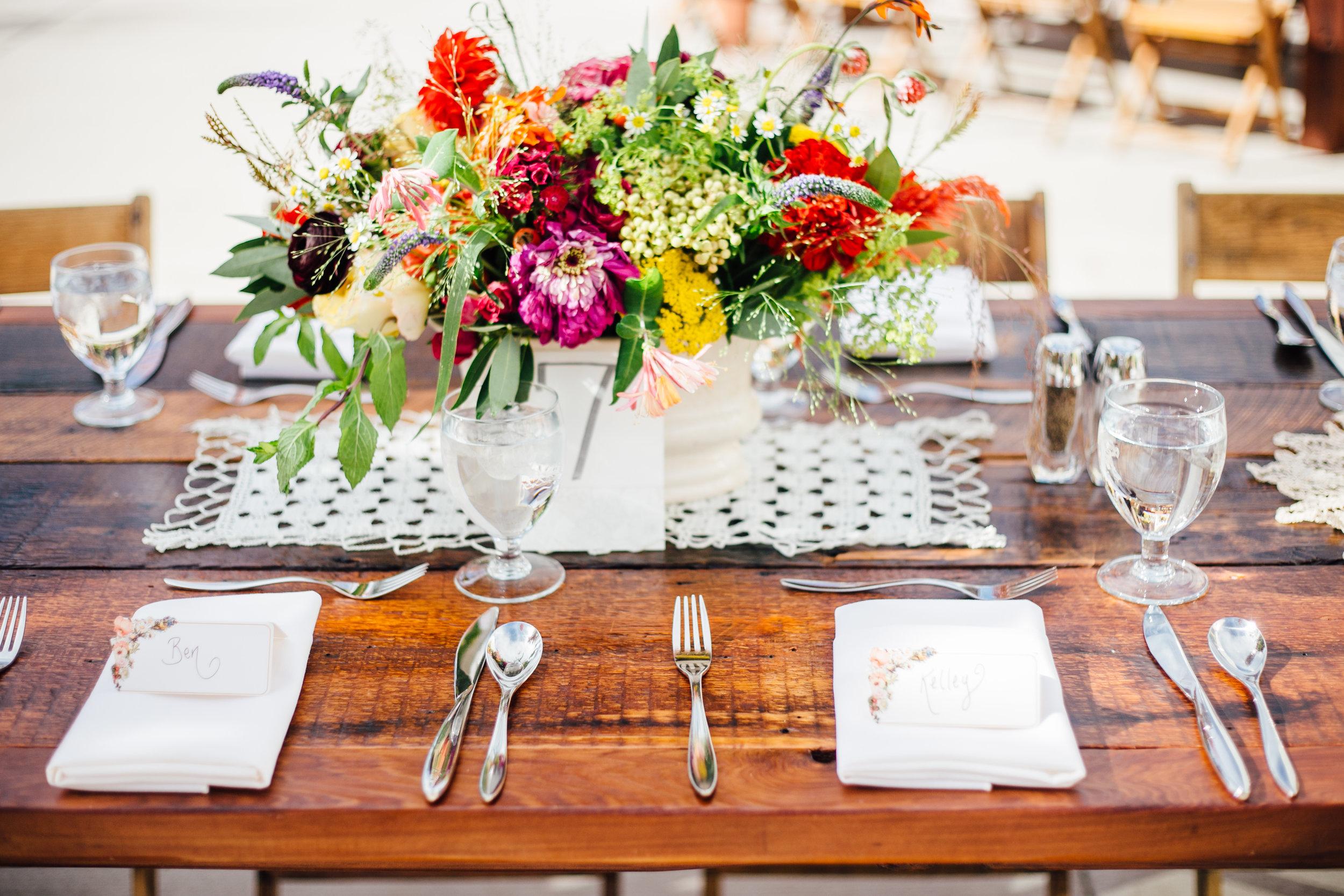 Bright Flowers and Square Doily Centerpiece Reception Brookside Gardens Berthoud Colorado Wedding
