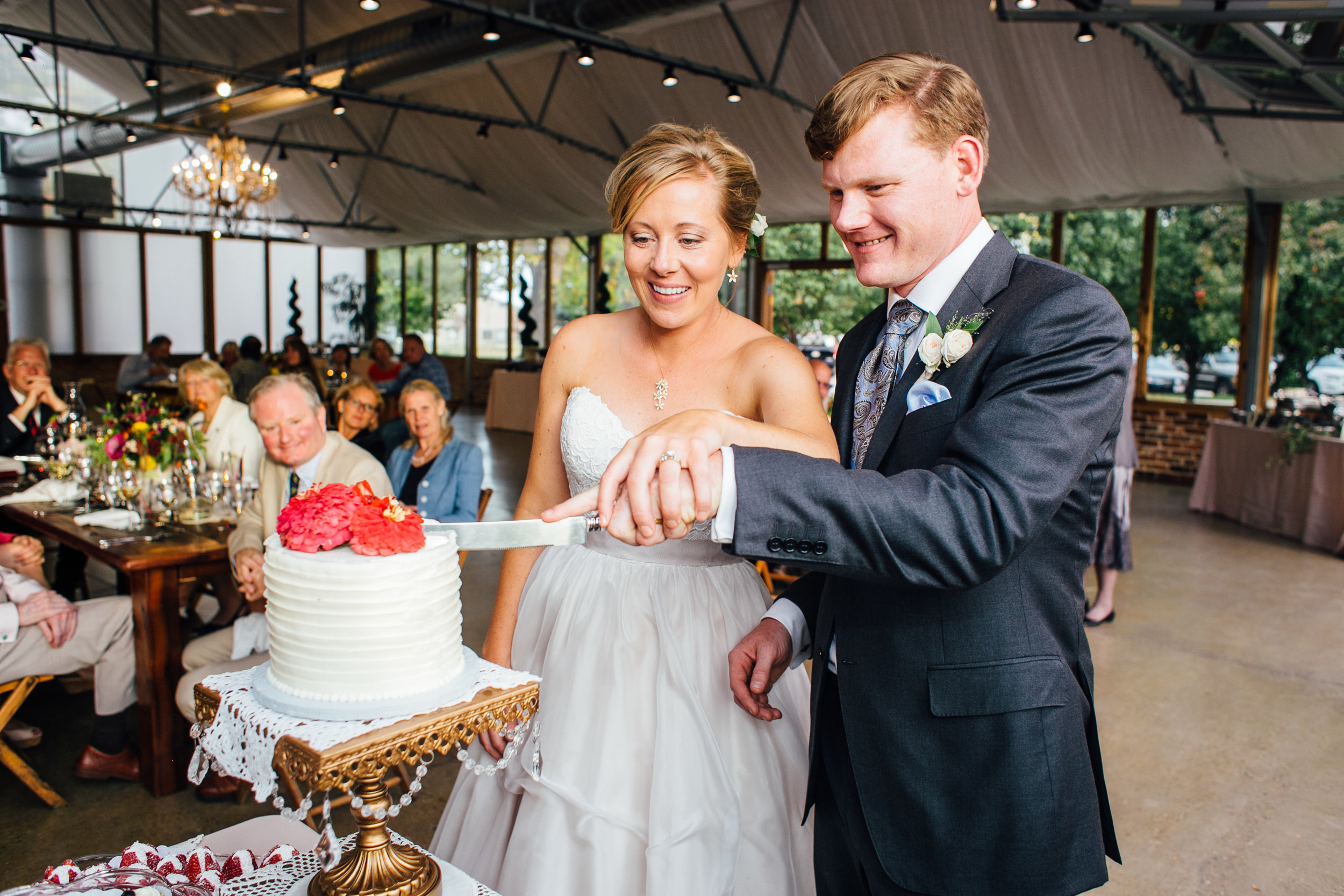 Bride and Groom Cut Cake Reception Brookside Gardens Berthoud Colorado Wedding
