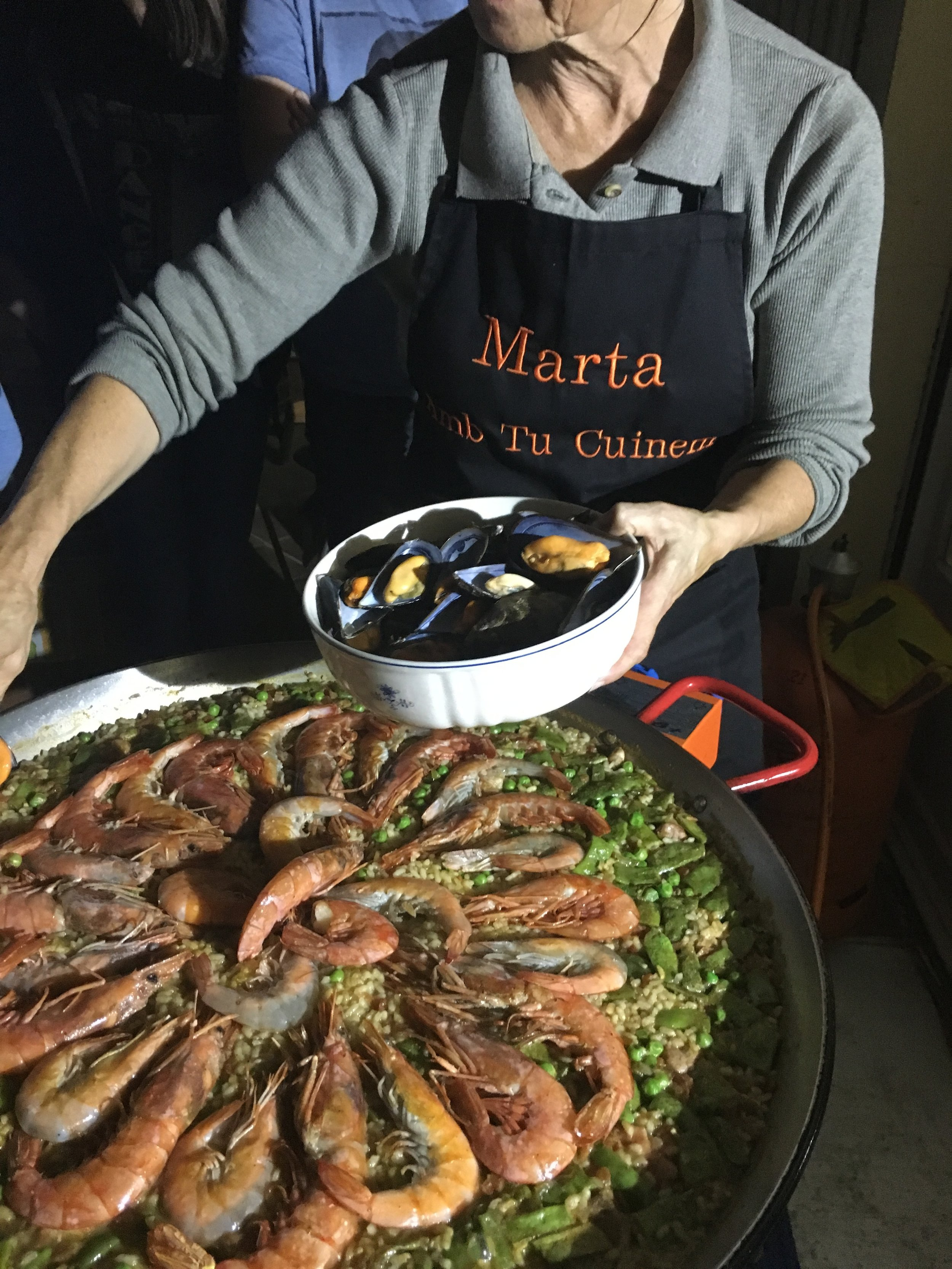The lovely Ms. Marta putting the finishing touches on the paella!