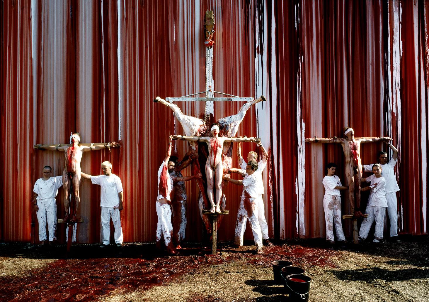 Hermann Nitsch Triple Crucifixion at The Six Day Aktion, Prinzendorf.  Portrait by Anthony Oliver