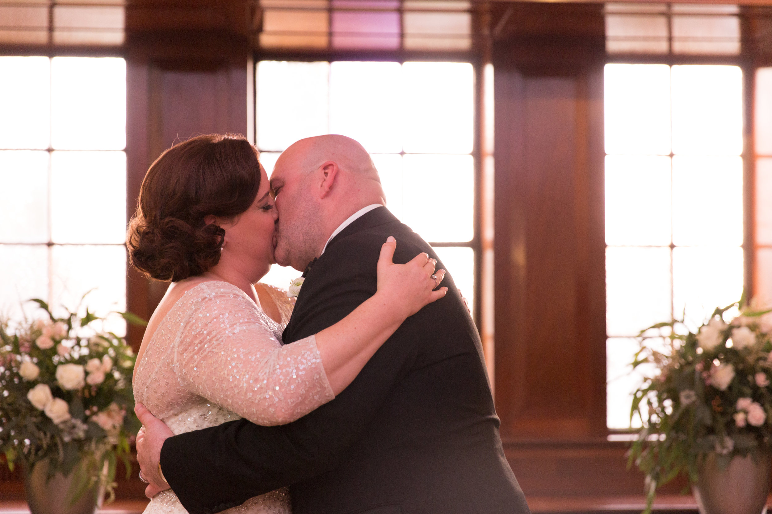 couple kissing after marriage