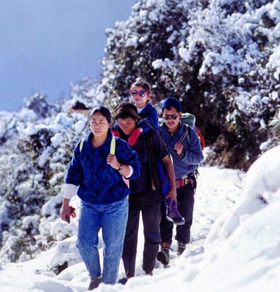 image via AboveTheClouds  Lisa, making trekking look good since 1990.