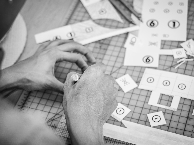 Copy of Hands of Jennifer Grimyser making Tableau Collage in her Art Studio in Brooklyn Neesh NYC