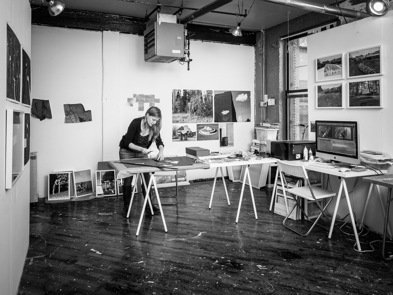 Artist Katarina Jerinic in her Studio with Photo Installation of Landscape Project
