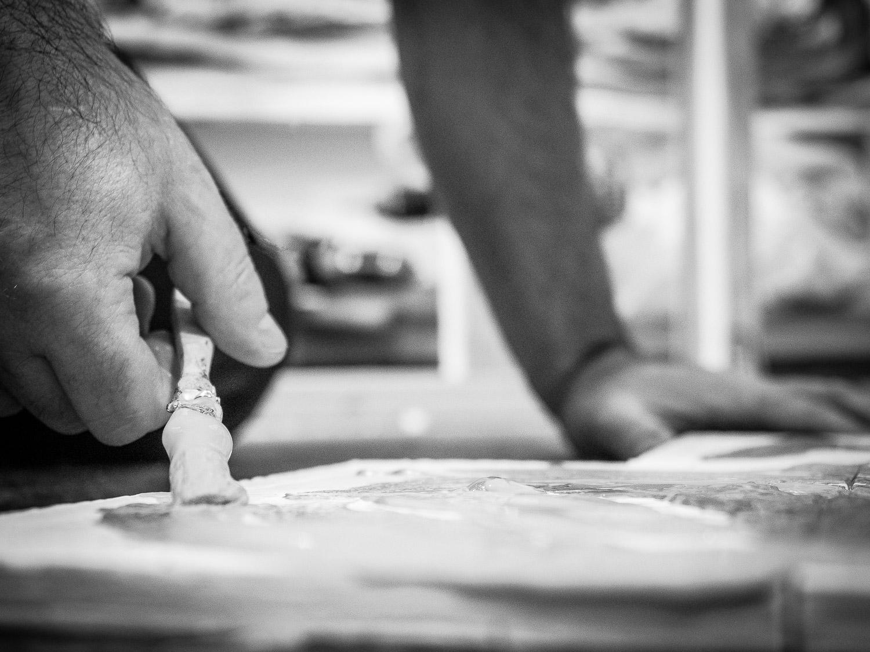 Hands of Matt Miller with Paintbrush work in progress Art Studio Bushwick Brooklyn Neesh NYC
