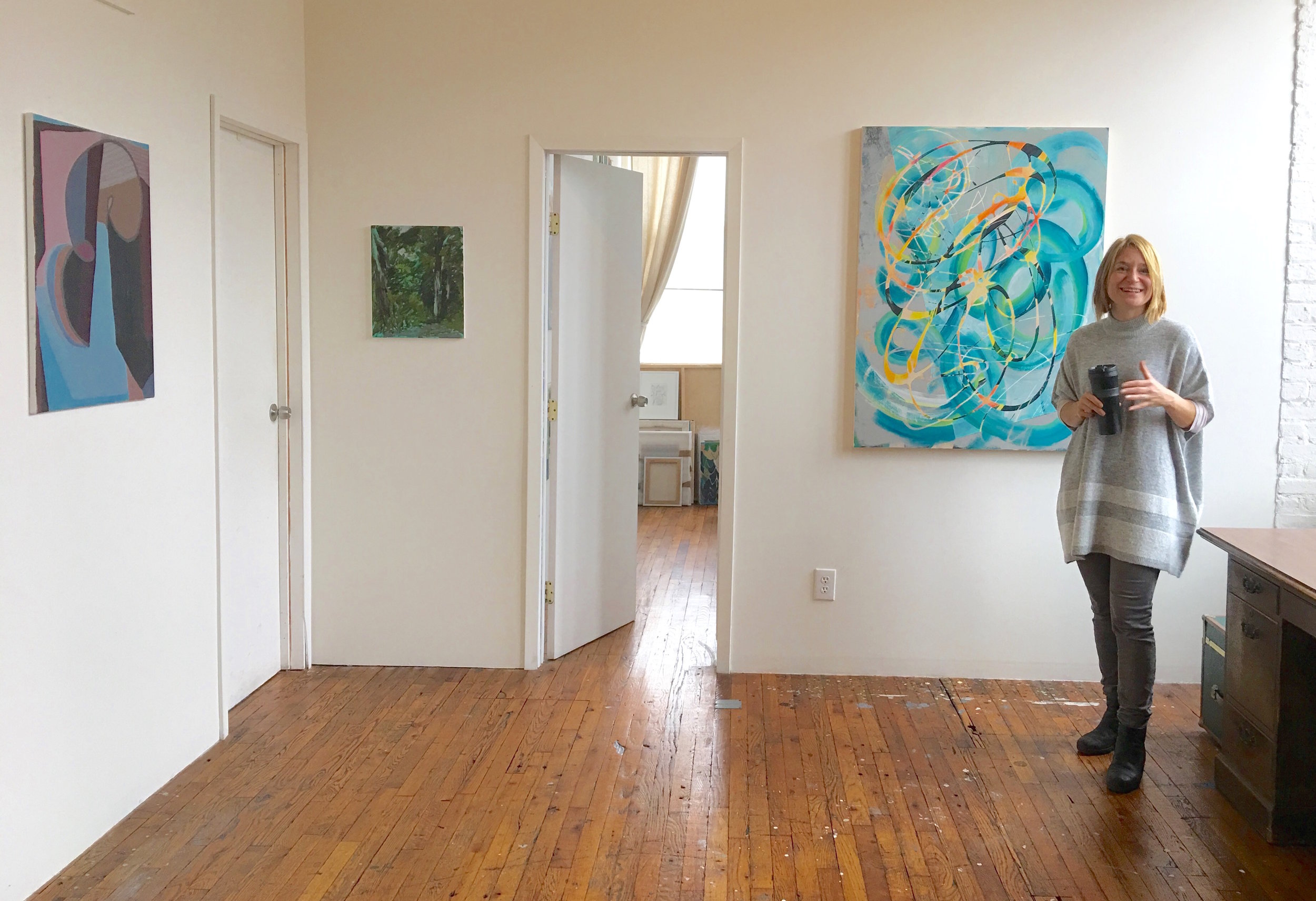Sarah Shirley infront of her work (right)