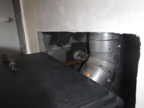 Connecting flue to stove following chimney relining