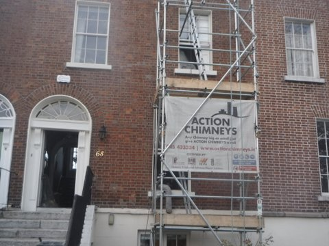 action chimneys scaffolding outside house