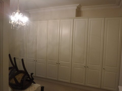 We had to disassemble / reassemble the wardrobes to gain access to chimney breast.