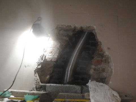 action chimneys flexable flue being installed