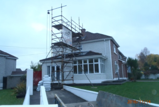 Scaffolding and skip on site