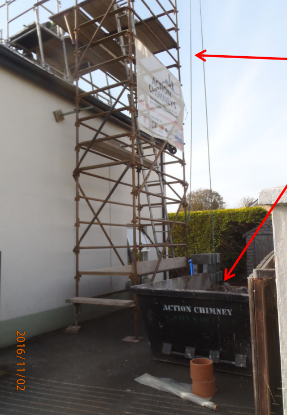 Scaffolding and skip on site for certified removal of waste material.
