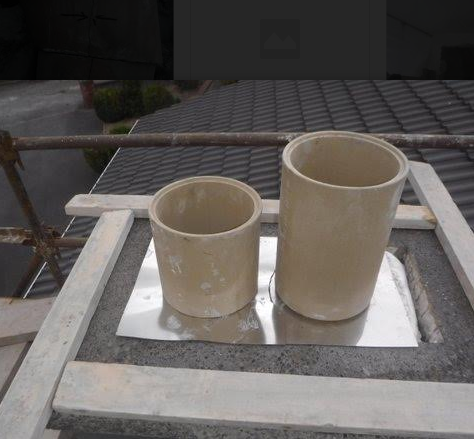 Chimney stack capping being fitted.