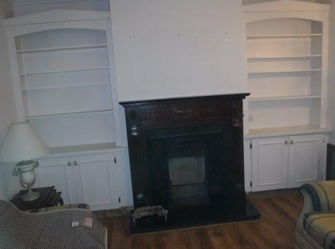 Completed room with new fireplace installed.