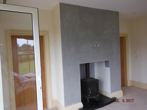 Completed chimney breast with stove installed.