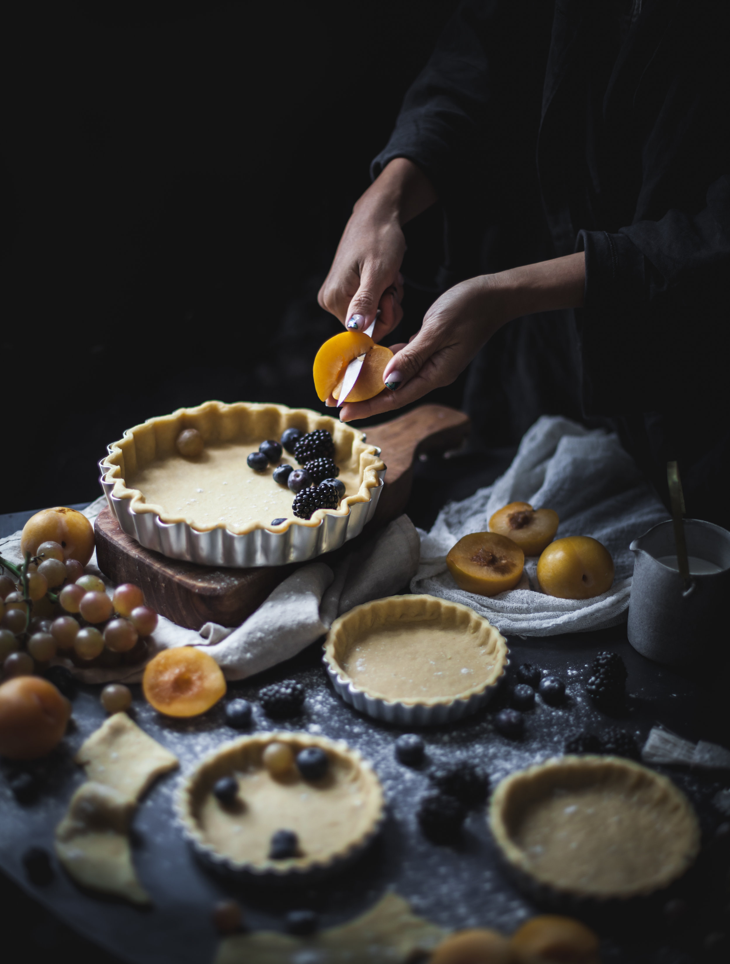 vegan tarts with plums and berries