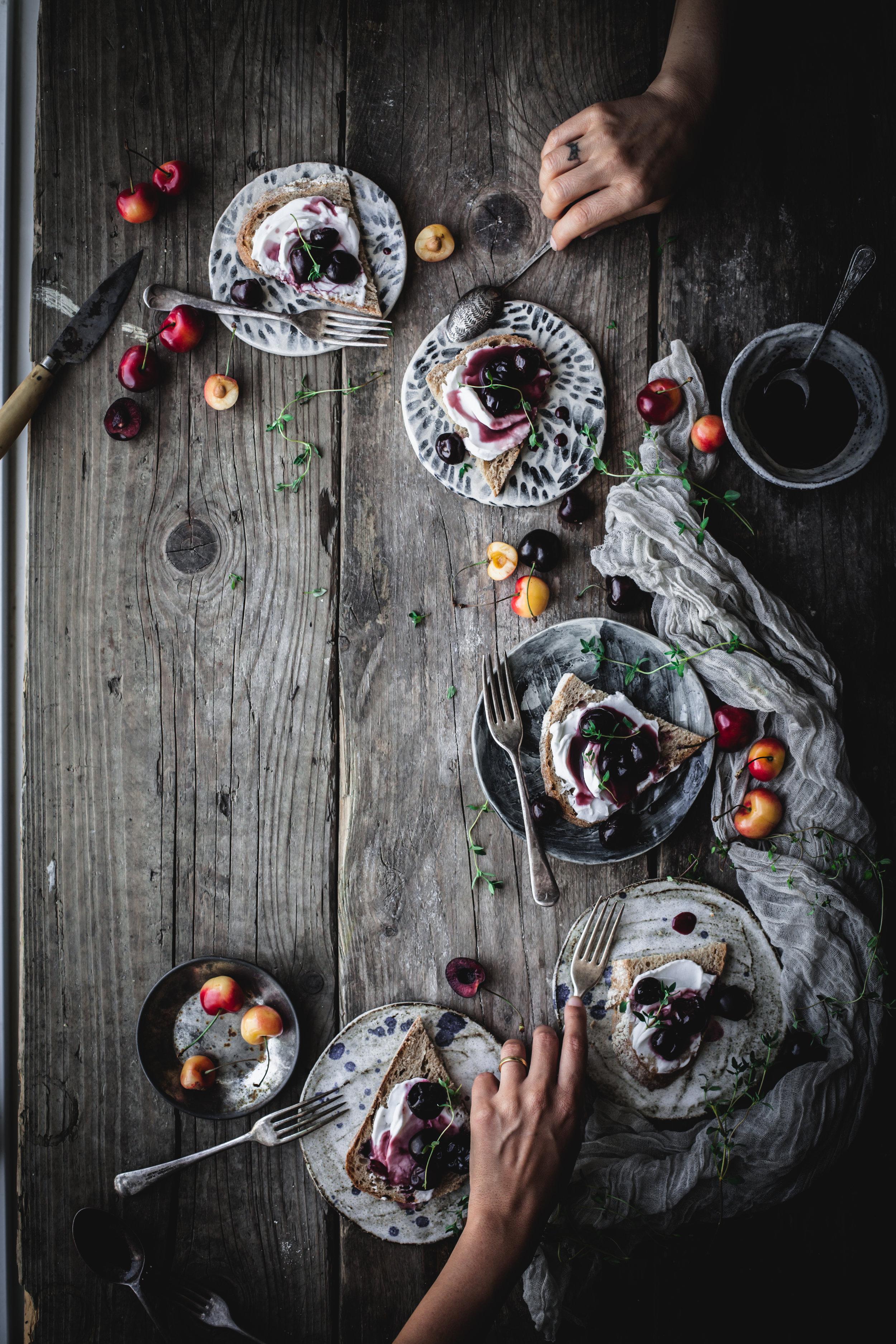 cherries and vegan cream cheese open sandwiches for breakfast