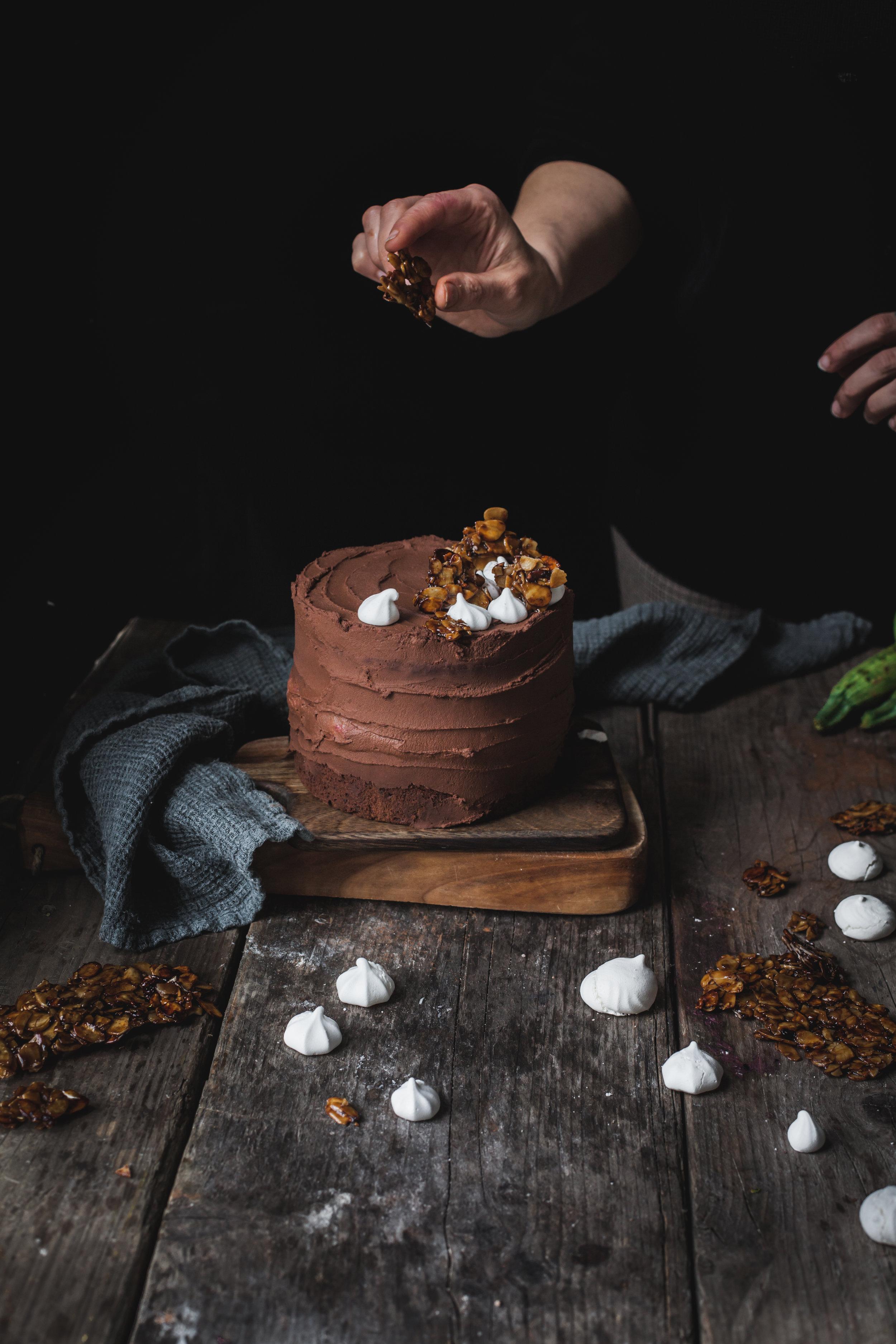 vegan zucchini chocolate cake with almond brittle