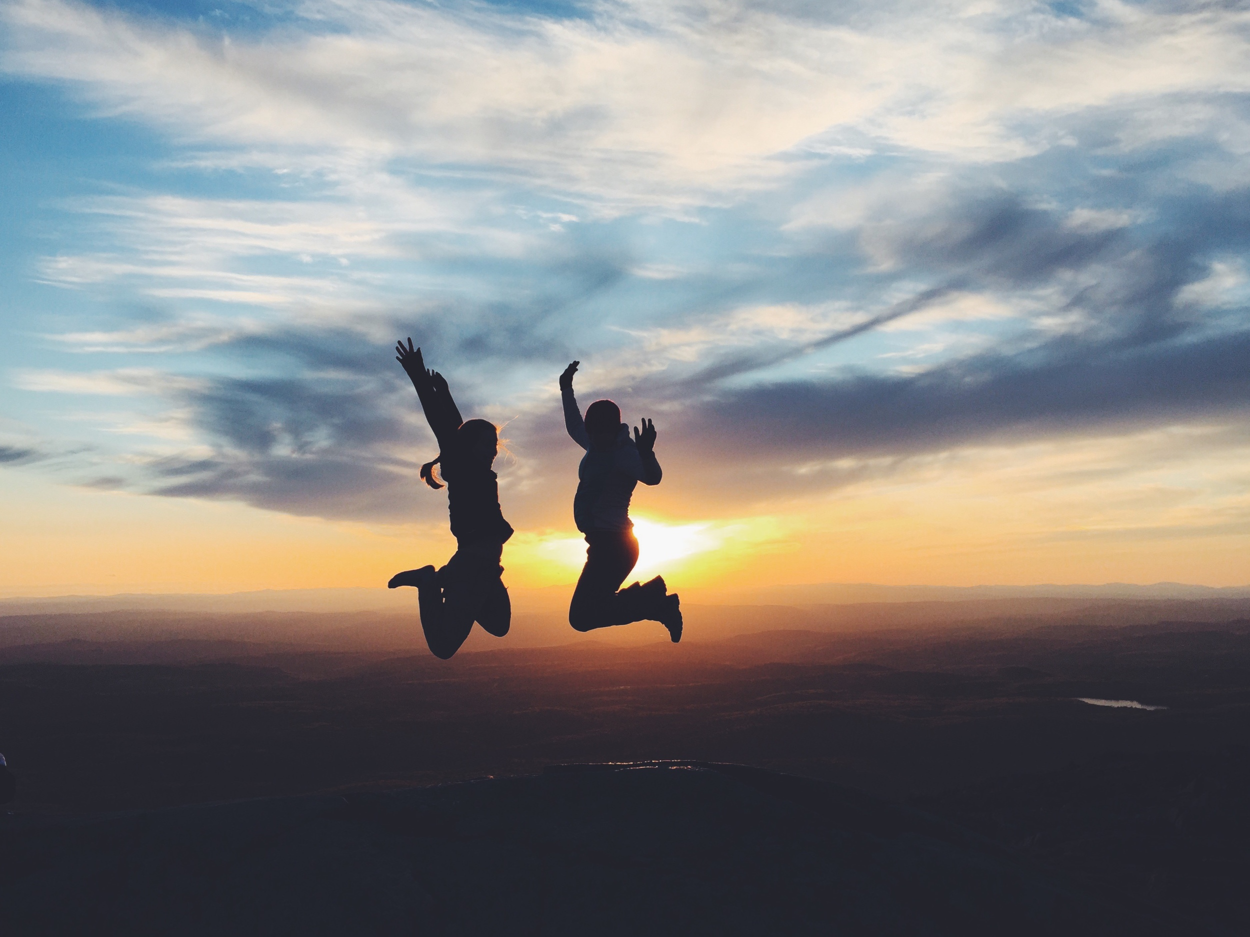 Jumping in Joy of the Sunset