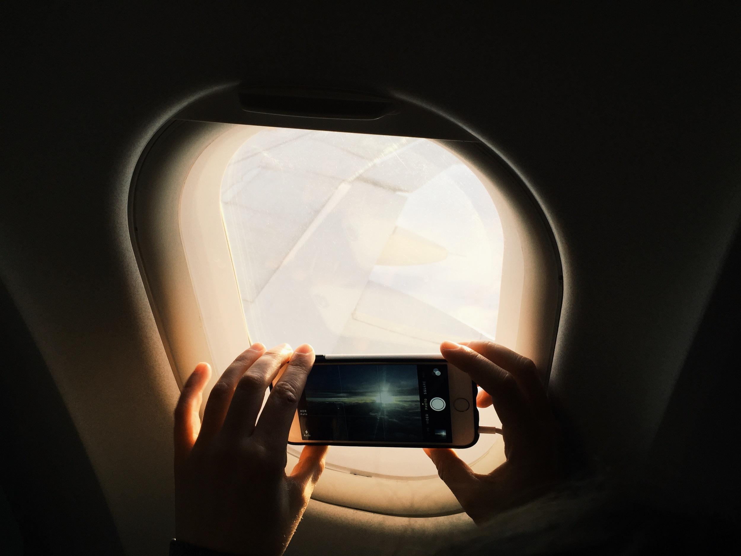 airplane-window-iphone-photo-hands