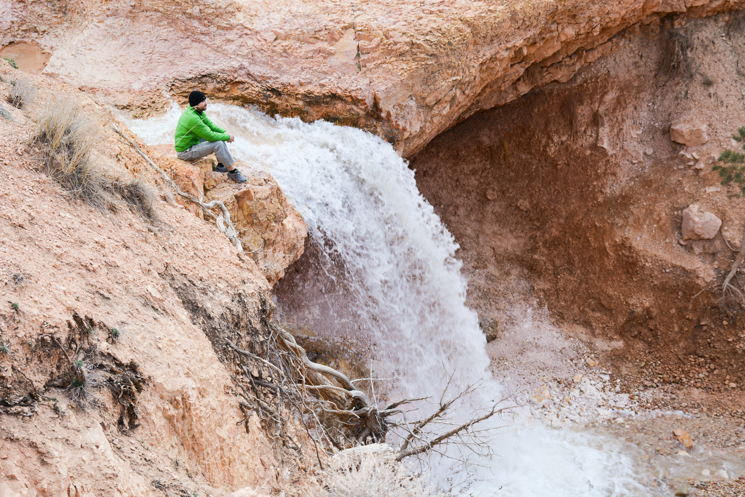 Contemplating near a waterfall in Bryce Canyon