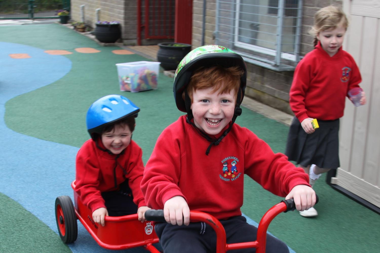 Confident, happy children ready to progress to primary school