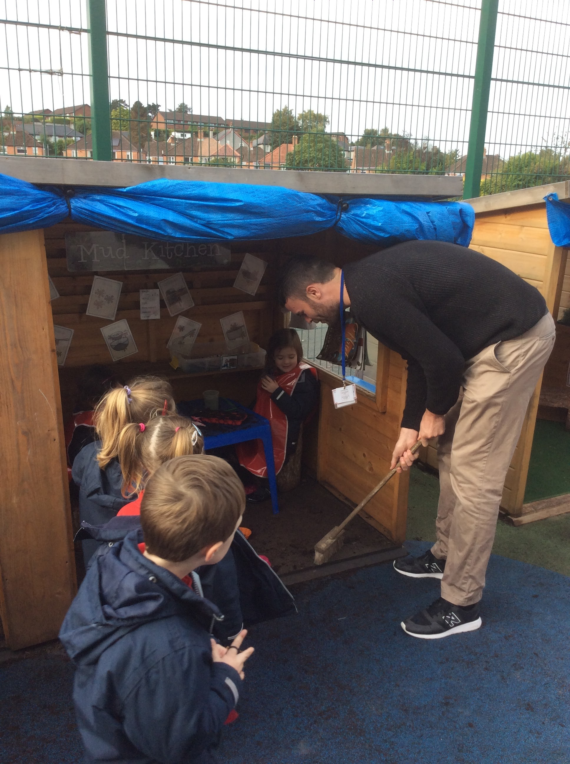 Fun in The Mud Kitchen....for the children and the Governors!