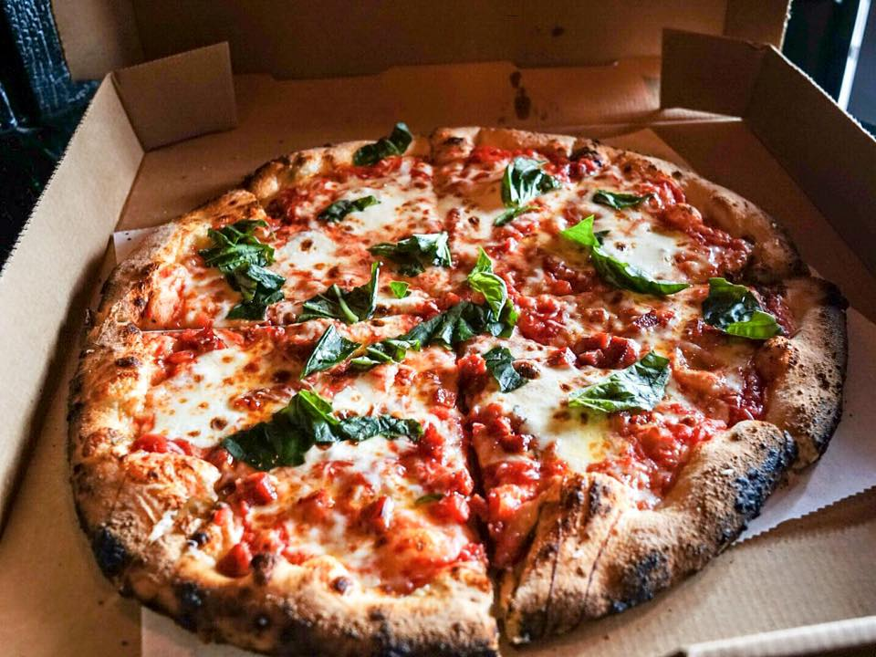 margherita - fresh mozzarella, house made san marzano tomato sauce and fresh basil