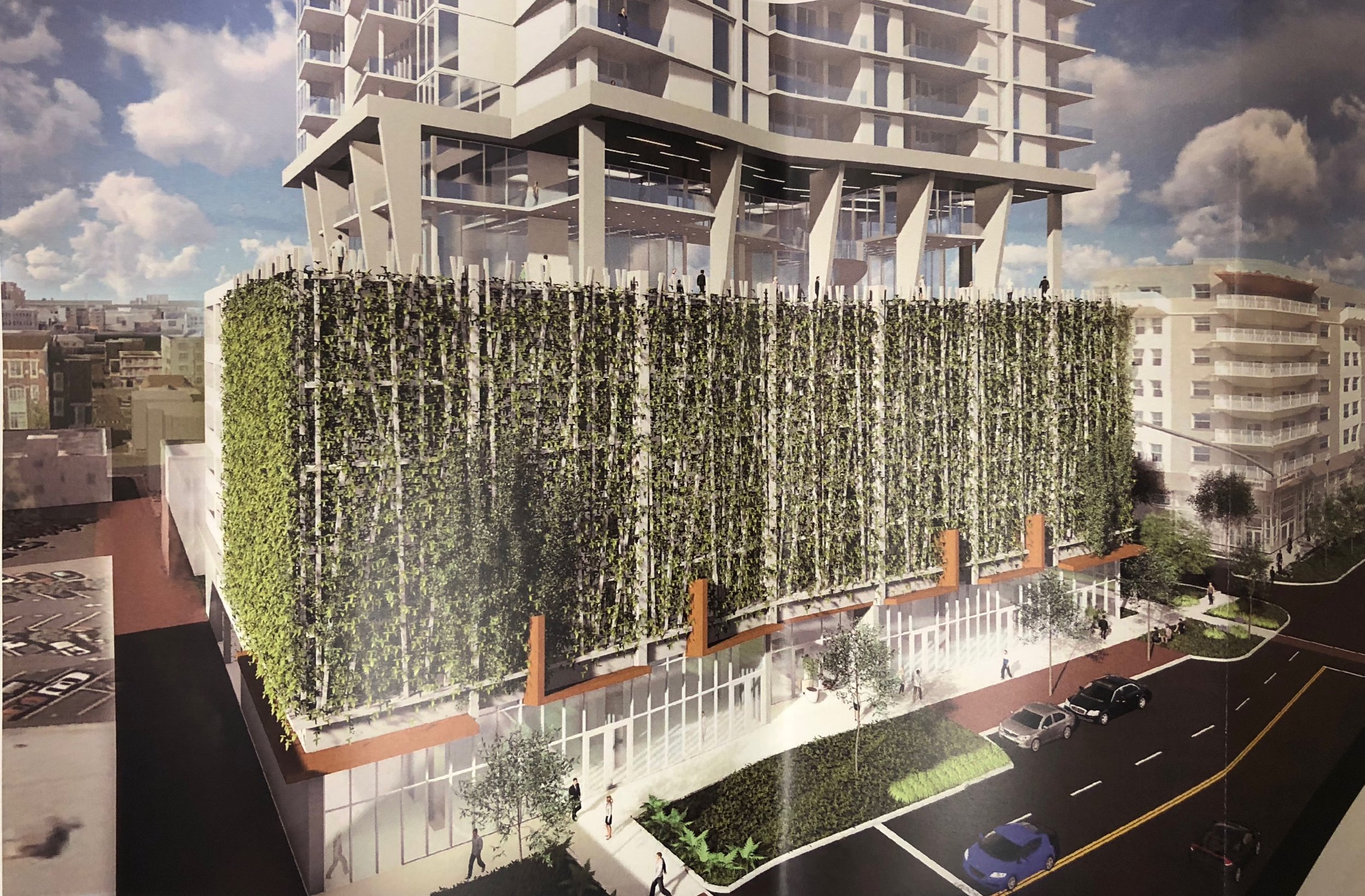 The project would contain 218 parking spaces in a garage that would be hidden from view behind aluminum screens with vertical vegetation such as vines or other greenery.