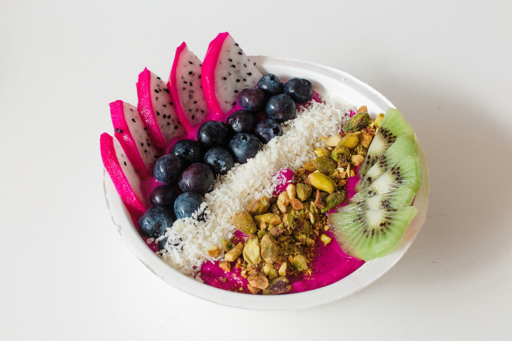 Sup-Succa  — Pitaya, coconut milk, strawberries, mango, agave. Topped with kiwi, dragonfruit, coconut flakes, pistachios, and edible flowers.