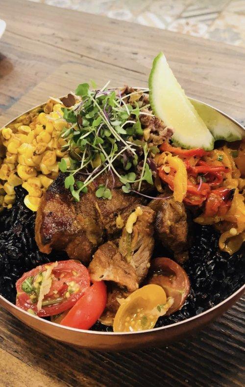 El TOro - braised pork shoulder, black rice, heirloom tomato salad, warm olive tapenade, charred corn succotash, chili oil, and micro cilantro.